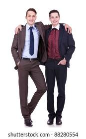 full body portrait of two friendly business men on white background