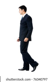 Full body portrait of walking business man, isolated on white background