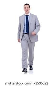 Full body portrait of walking businessman, isolated on white background
