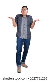Full body portrait of young Asian man wearing batik shirt and glasses standing shrug I dont know innocent gesture, isolated on white