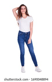 Full body portrait of a young beautiful brunette model in blue jeans, isolated on white background