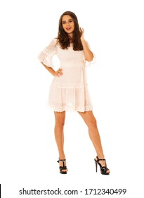 Full body portrait of a young beautiful brunette model in white dress, isolated on white background