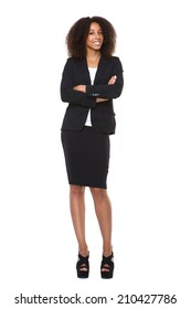 Full body portrait of a young business woman smiling on isolated white background