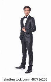 Full body Portrait of young businessman standing on white background