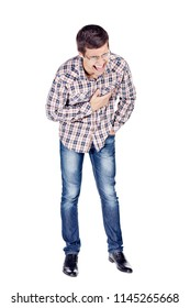 Full body portrait of young man doubling up with laughter, wearing metal frame glasses, checkered shirt, blue jeans and black shoes isolated on white background