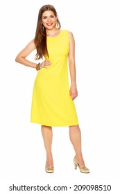 Full body portrait of young woman in yellow dress. White background.