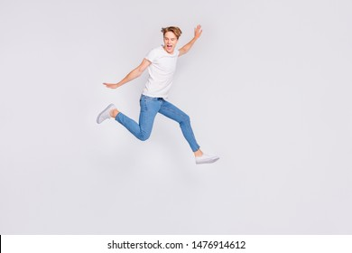 Full body profile photo of jumping high guy feel himself lightweight wear casual outfit isolated white background