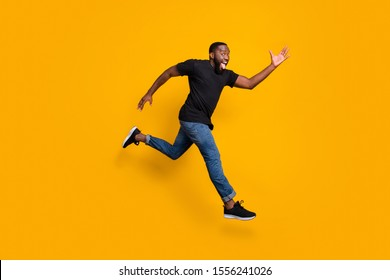 Full body profile side photo of funky crazy afro american guy jump run fast after bargains wear trendy outfit isolated over bright color background