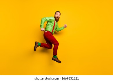 Full body profile side photo of astonished man jump run hurry incredible discounts stare stupor wear suspenders trousers isolated over shine color background