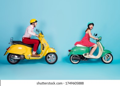 Full body profile side photo of crazy funky energetic two people man woman driver ride motor bike on high speed scream wear red dress shirt pants isolated over blue color background