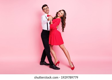 Full body profile side photo of young couple happy positive smile dance wear glamour outfit isolated over pastel color background