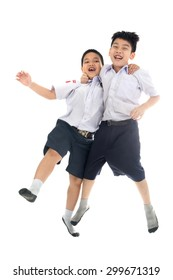 Full body shot of asian primary school students back from school, Isolate on white background