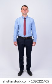 Full body shot of businessman wearing shirt and tie