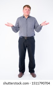 Full body shot of confused overweight businessman shrugging shoulders