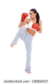 Full body shot of female kick boxer over white background