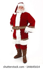 Full Body Shot of Santa Claus with his hands on his hips isolated on white background