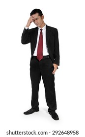 Full body shot of young Asian businessman standing and having a headache, isolated on white background