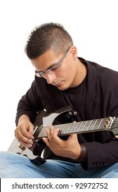 full body shot  of a young guitar player with his guitar, isolated on white