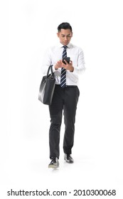 Full body shot of young handsome businessman in white shirt ,tie using cellphone with handbag standing in studio