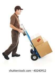 Full body side view of a delivery man or mover carrying boxes on a hand truck.  Isolated