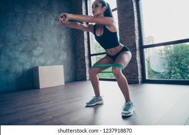 Full body size length of attractive beautiful charming sporty sportive lady wearing sports top and panties with perfect lines figure form doing sit-ups. Abs body sculpt class trainer instructor indoor