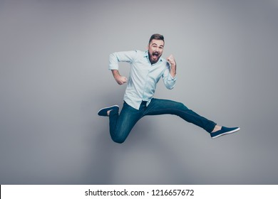 Full body size length studio photo portrait of crazy mad optimistic positive guy with open mouth looking at camera isolated gray background copy space
