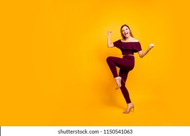 Full body size length view photo portrait of funky comic cool nice glad cheerful joyful carefree girl wearing burgundy suit running going moving lady raising fists up isolated bright background