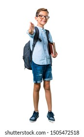 Full body of Student boy with backpack and glasses handshaking after good deal on isolated white background