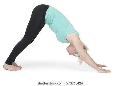 """Full body view of a young blond woman in yoga exercise """"Triangle"""" against white background with light shadow."""