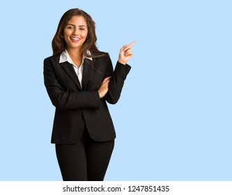 Full body young busines woman pointing to the side with finger