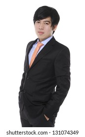 Full body young business man standing with hands in pocket