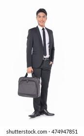 Full body young business man carrying a suitcase on white background