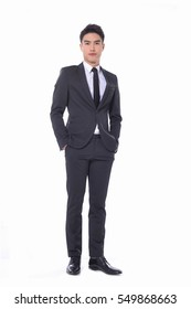 Full body young businessman standing on white background