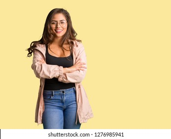 Full body young curvy woman crossing arms, smiling and relaxed