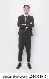 Full body Young handsome man with wearing suit with white shirt with pants and black leather shoes with arms crossed in studio
