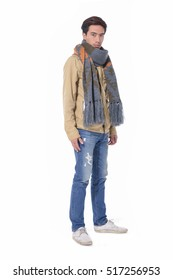 Full body young handsome man fashion in scarf ,jeans portrait, studio shot
