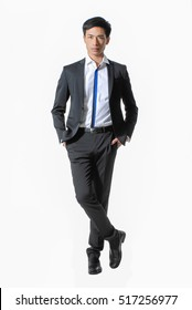 Full body young handsome man posing in studio wearing fashionable suit