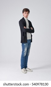 Full body young man Casual standing on gray background