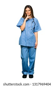 Full body of Young nurse showing a sign of silence gesture putting finger in mouth