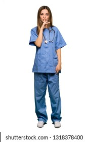 Full body Young nurse showing a sign of silence gesture putting finger in mouth on isolated background
