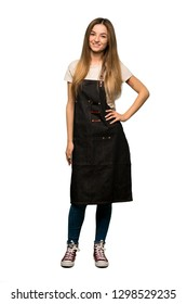 Full body Young woman with apron posing with arms at hip and smiling on isolated background