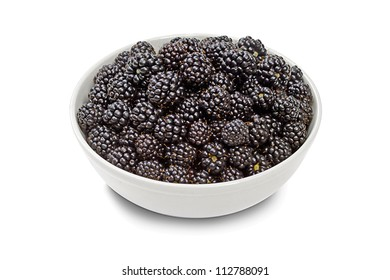 full bowl of blackberries on a white background