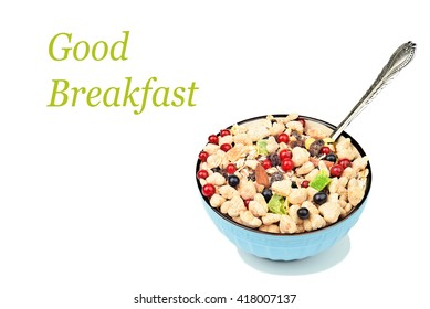 """full bowl of muesli with berries and spoon on a white isolated background with the inscription """"Good Breakfast"""""""