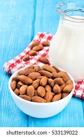 Full bowl of nuts with almond milk closeup