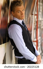 Full boyd portrait of young male model in tie and vest