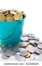 a full bucket of coins on white background