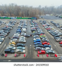 Full of car parked in a public parking lots. Tilt-shift effect