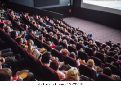 Full cinema, people on the seats from the top of theater