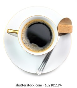 full coffee cup, spoon and  brown sugar qube