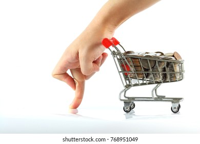 full of coins in the shopping cart, which have a woman hand to lean on it isolated on white background, in concept of economic growing, money saving, passive income